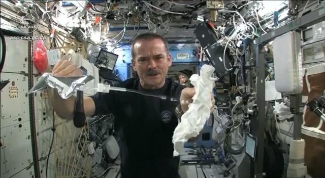 wringing a towel in space